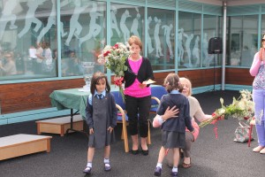 Junior infants giving the teachers their flowers